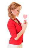 Woman holding heart-shaped candy Royalty Free Stock Images