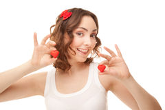 Woman holding heart-shaped cookies Stock Photography