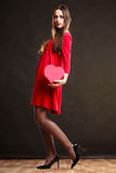 Woman holding heart shaped gift box Stock Photos