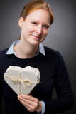 Woman Holding a Heart Shaped Gift Stock Photos