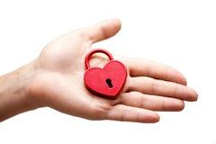 Woman holding heart shaped lock. Woman holding a heart shaped lock Stock Photos