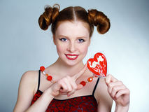 Woman Holding Heart Shaped Lollipop Stock Image