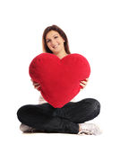 Woman holding heart-shaped pillow Stock Photos
