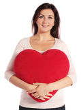 Woman holding heart-shaped pillow Royalty Free Stock Images