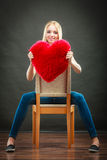 Woman holding heart shaped pillow love symbol Royalty Free Stock Image