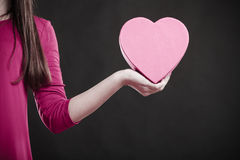Woman holding heart sign. Part body. Royalty Free Stock Photography