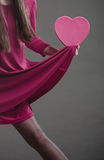 Woman holding heart sign. Part body. Stock Photo