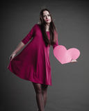 Woman holding heart sign. Royalty Free Stock Photos