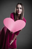 Woman holding heart sign. Stock Photography