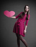 Woman holding heart sign. Stock Image