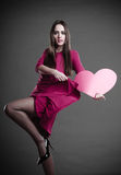 Woman holding heart sign. Royalty Free Stock Photo