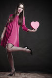 Woman holding heart sign. Royalty Free Stock Image
