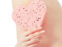 Woman holding heart sponge closeup Royalty Free Stock Photography
