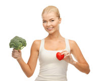 Woman holding heart symbol and broccoli Royalty Free Stock Photography