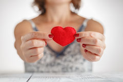 Woman holding a heart symbol in her hands Stock Photos