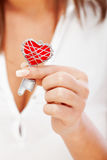 Woman holding heartshaped key Stock Images