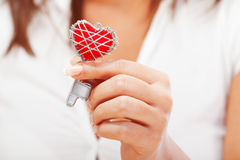 Woman holding heartshaped key Royalty Free Stock Image