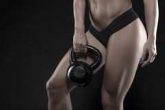 Woman holding heavy kettlebell closeup Royalty Free Stock Photos