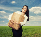 Woman holding heavy paper bag at outdoor Royalty Free Stock Photo