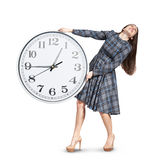 Woman holding heavy white clock Royalty Free Stock Images