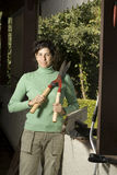 Woman Holding a Hedge Clipper - Vertical Stock Image