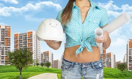Woman holding helmet and rolls of paper. Cropped Royalty Free Stock Photo