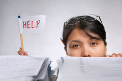 Woman holding help flag Stock Image