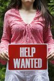 Woman holding help wanted sign Stock Photos