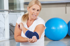 Woman holding her aching elbow stock images