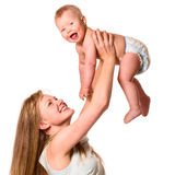 Woman is holding her baby Royalty Free Stock Image