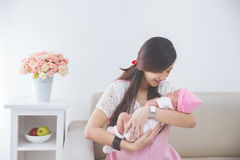 Woman holding her baby girl Stock Image