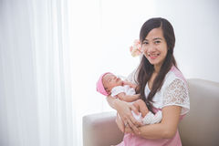 Woman holding her baby girl Stock Photography