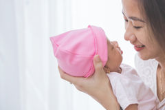 Woman holding her baby girl, close up Royalty Free Stock Photo