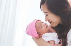 Woman holding her baby girl, close up Stock Photography