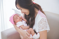 Woman holding her baby girl, close up Royalty Free Stock Photography