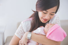 Woman holding her baby girl, close up Royalty Free Stock Photos