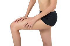 Woman holding her beautiful healthy leg with massaging knee and calf in pain area. Stock Photo