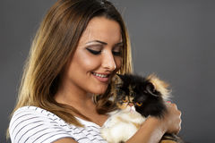 Woman holding her cat Royalty Free Stock Photo