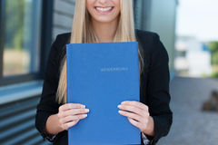 Woman holding her curriculum vitae. Detailing her experience and qualifications as she prepares herself for a corporate job interview Royalty Free Stock Photos
