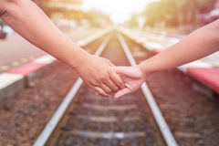 Woman holding her daughter hand at the railway Stock Photography