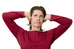 Woman holding her ears Stock Photography