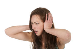 woman holding her ears Stock Images