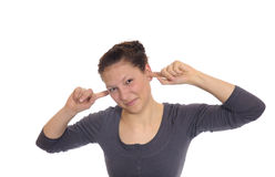 Woman holding her ears to Stock Images