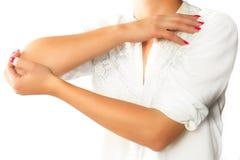 Elbow pain on white isolated background. stock image