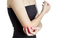 A woman holding her elbow in pain, with red highlighted on pain area on a white background Stock Images