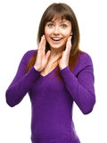 Woman is holding her face in astonishment Royalty Free Stock Photos