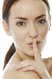 Woman holding her finger over her lips Royalty Free Stock Photography