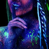 Woman holding her finger to her lips. In a gesture for silence. Cosmic woman, ultraviolet body art Stock Images