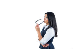 Woman holding her glasses against her lips Royalty Free Stock Photo
