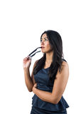 Woman holding her glasses against her lips Royalty Free Stock Image